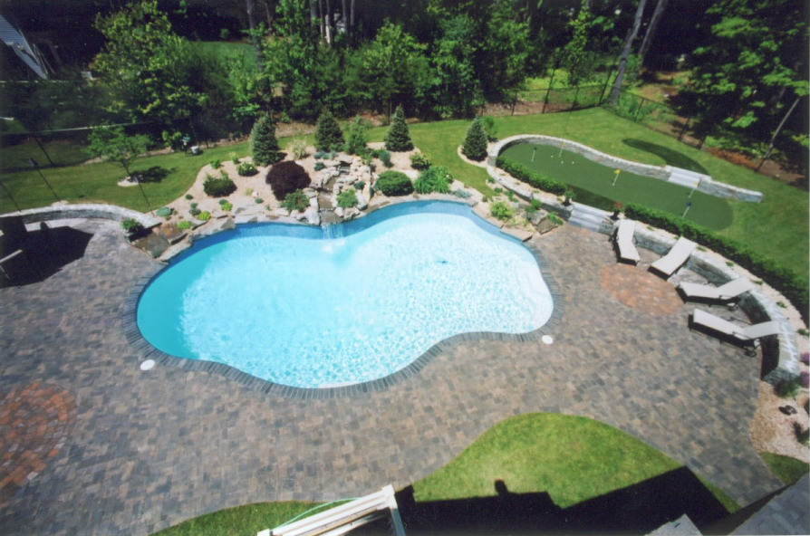Pool surrounded by artificial turf