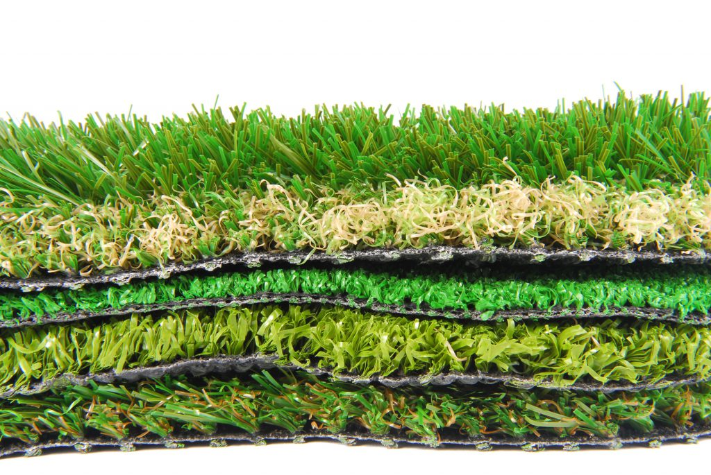 can you put artificial grass on top of real grass